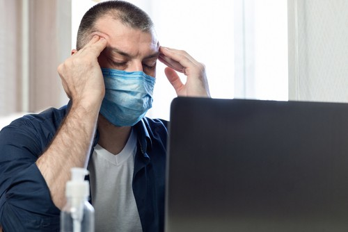 stressed man with mask